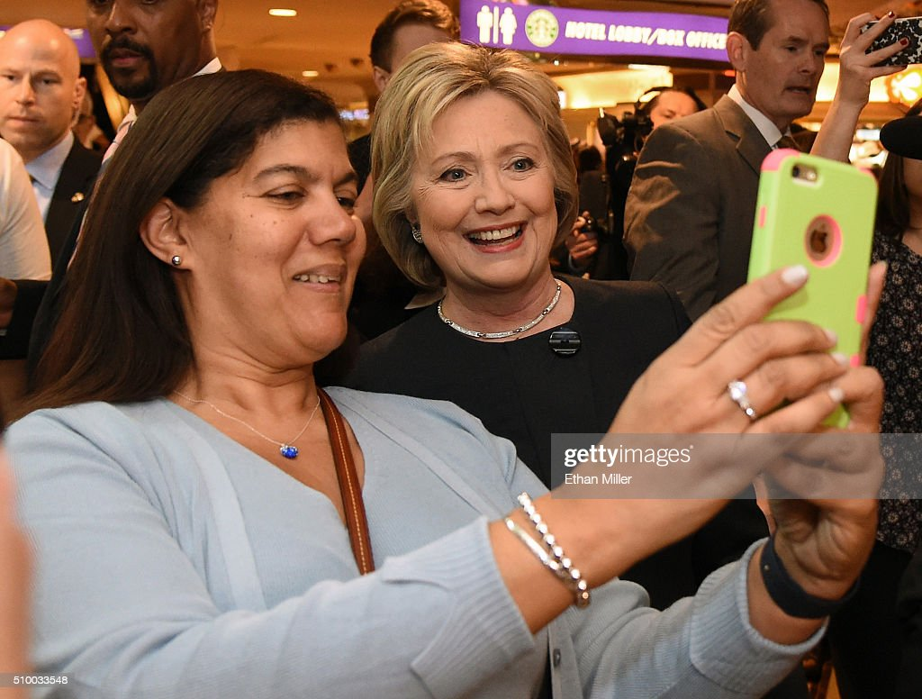 A tourist takes a selfie with Democratic presidential candidate <a gi-track='captionPersonalityLinkClicked' href=/galleries/search?phrase=Hillary+Clinton&family=editorial&specificpeople=76480 ng-click='$event.stopPropagation()'>Hillary Clinton</a> (R) poses for a photo as she walks through Harrah's Las Vegas on February 13, 2016 in Las Vegas, Nevada. Clinton is challenging Sen. Bernie Sanders for the Democratic presidential nomination ahead of Nevada's Feb. 20 Democratic caucus.