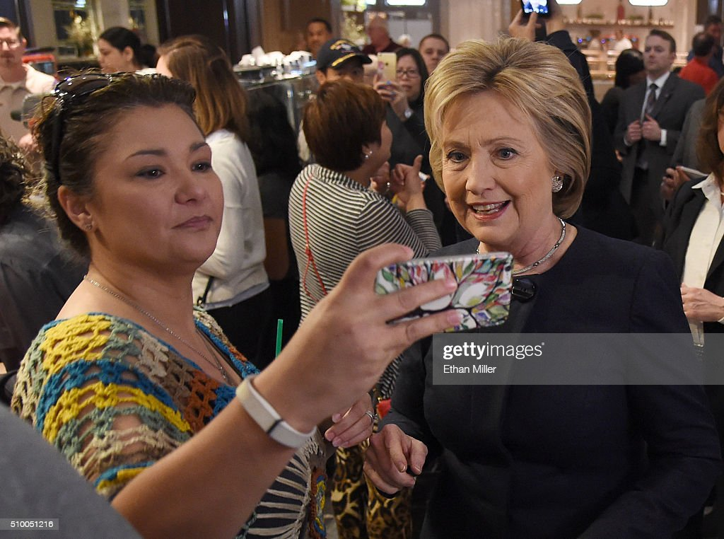A tourist takes a selfie with Democratic presidential candidate <a gi-track='captionPersonalityLinkClicked' href=/galleries/search?phrase=Hillary+Clinton&family=editorial&specificpeople=76480 ng-click='$event.stopPropagation()'>Hillary Clinton</a> (R) as she walks through a cafe at Harrah's Las Vegas on February 13, 2016 in Las Vegas, Nevada. Clinton is challenging Sen. Bernie Sanders for the Democratic presidential nomination ahead of Nevada's Feb. 20 Democratic caucus.
