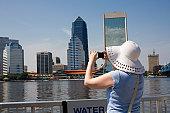 A tourist taking a photo of the skyline
