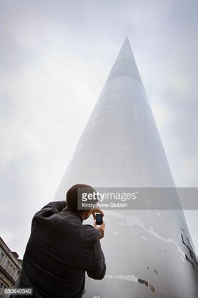Tourist taking picture of the Spire of Dublin, Dublin, Ireland