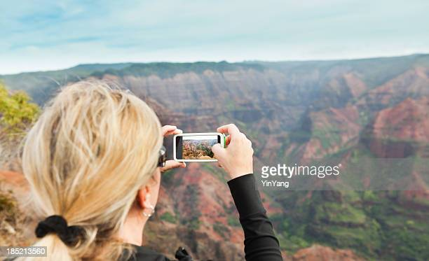 Tourist Taking Picture of the Waimea Canyon in Kauai Hawaii