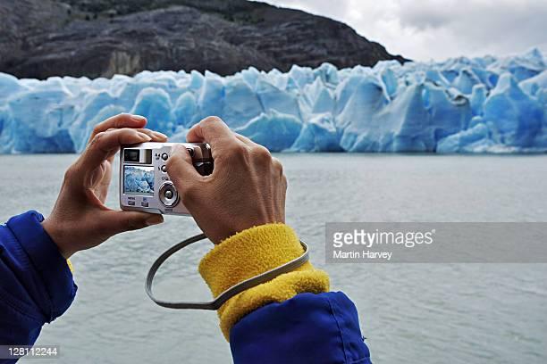 Tourist taking pictures of glaciers at Glaciar Grey. Torres del Paine National Park. Chile. (Digital Composite)