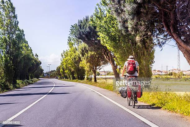 Tourist travelling with a loaded bicyle