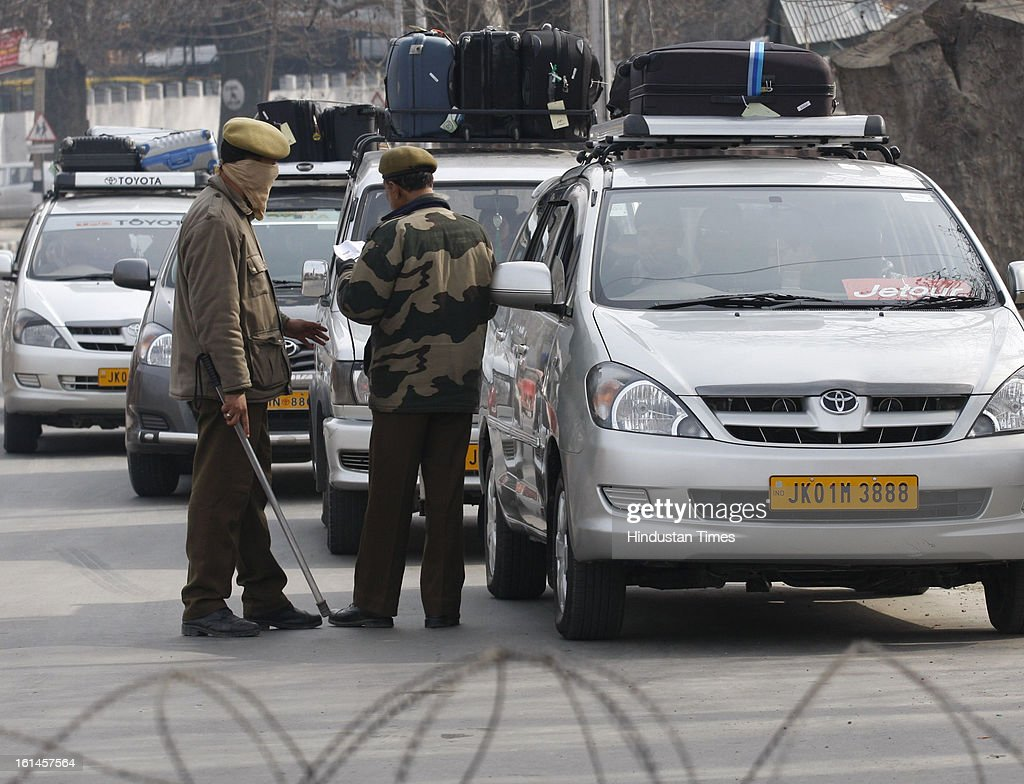 Tourist vehilcles being cheked by police while leaving Srinagar on the 3rd day of curfew on February 11, 2013 in Srinagar, India. Kashmir Valley remained under curfew for the third day today even as mobile and Internet services remained suspended following hanging of Parliament attack convict Mohammad Afzal Guru.