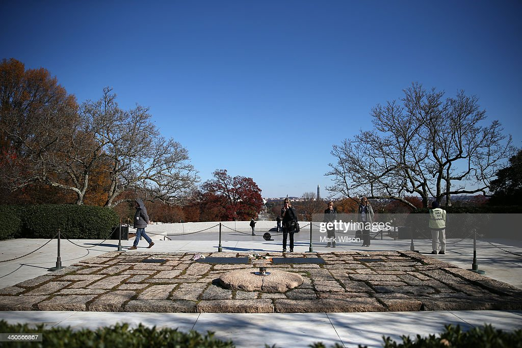 Tourist visit the gravesite of the 35th President of the United States John F. Kennedy, at Arlington Cemetery on November 19, 2013 in Arlington, Virginia. The 50th anniversary of President Kennedy's assassination is Friday November 22, 2013.
