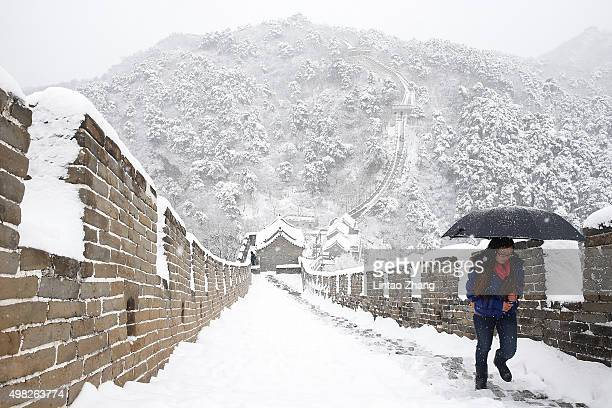 Tourist visit the Mutianyu Great Wall covered in snow at Huairou District on November 22 2015 in Beijing China