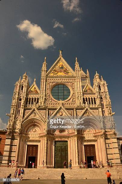 Tourist Visiting Siena Cathedral Against Sky
