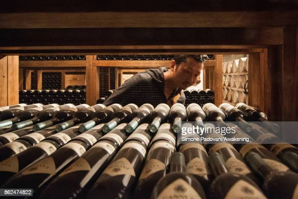 A tourist visits a winery of Barolo on October 17 2017 in the Barolo region Italy Because of the high summer temperatures Barolo's harvest has been...