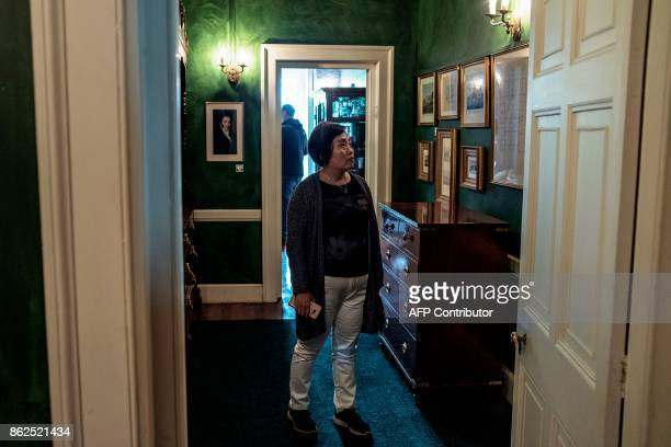 A tourist visits on October 17 2017 the last residence of Napoleon in exile at Longwood on the British Overseas Territory of Saint Helena / AFP PHOTO...