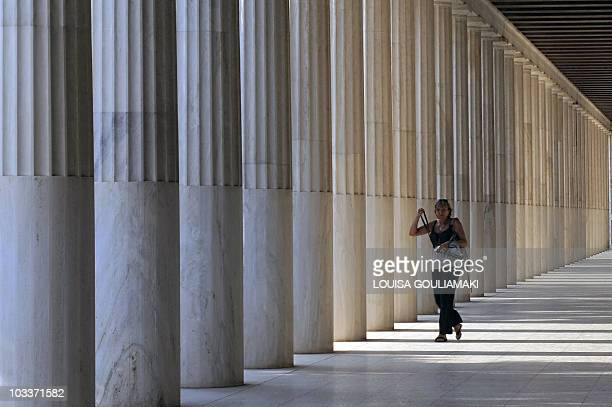 A tourist visits the 159138 BC Stoa of Attalos a gift from the King of Pergamon Attalos II at the Ancient Agora in Athens on August 13 2010 AFP PHOTO...