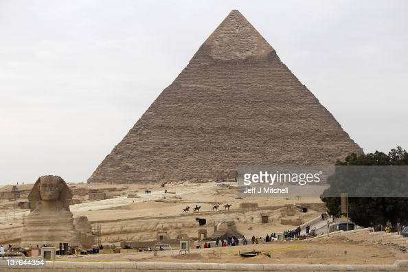 Tourist visits the Giza Pyramids and Sphinx in Cairo on January 24 2012 in Cairo Egypt The country is struggling with falling tourism figures and...