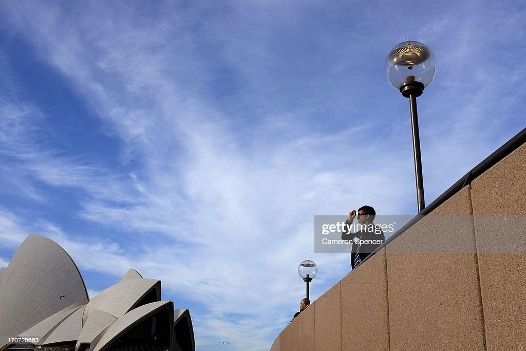 A tourist visits the Sydney Opera House on June 11, 2013 in Sydney, Australia. The New South Wales government is expected to commit AUD $14 million in it's 2014-15 budget to a ten year plan that will see the Sydney Opera House refurbished and it's facilities upgraded. The world-heritage listed landmark will celebrate it's 40th anniversary this October.
