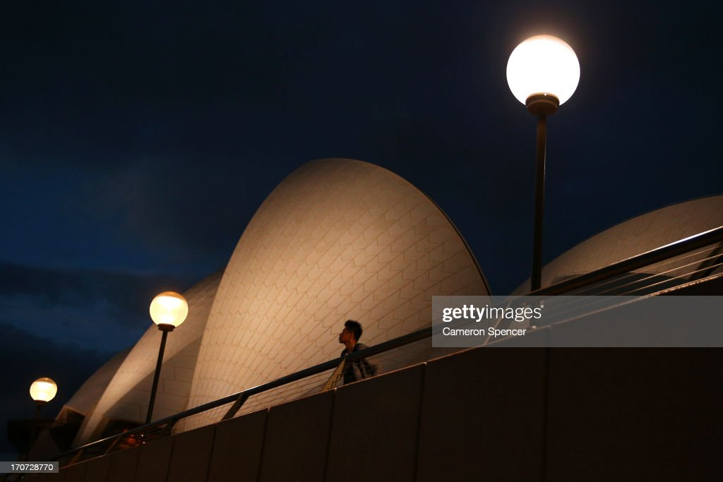 A tourist visits the Sydney Opera House on June 13, 2013 in Sydney, Australia. The New South Wales government is expected to commit AUD $14 million in it's 2014-15 budget to a ten year plan that will see the Sydney Opera House refurbished and it's facilities upgraded. The world-heritage listed landmark will celebrate it's 40th anniversary this October.