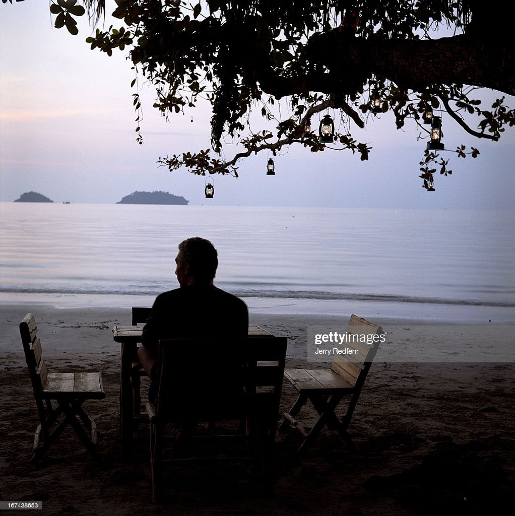 A tourist waits for a drink at a beachfront bar on Koh Chang Island..
