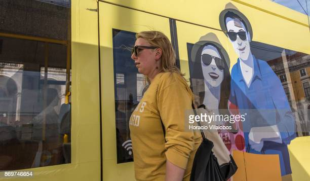 A tourist waits to board the E15 line tram connecting Praca da Figueira with Alges in Praca do Comercio on October 21 2017 in Lisbon Portugal E15...