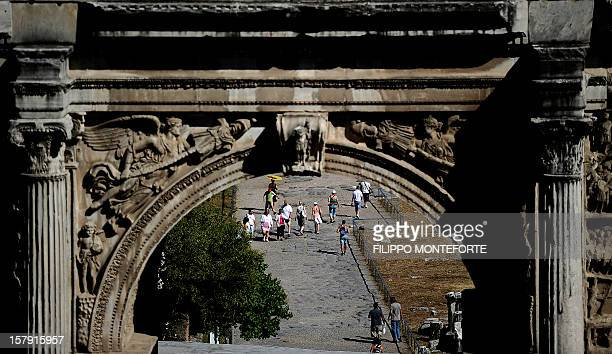 Tourist walk in the Imperial forums by the Arch of Settimo Severo in downtown Rome on July 31 2010 Rome's municipality approved their budget today...