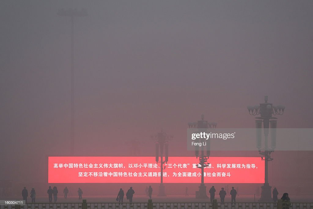 Tourist walk on the Tiananmen Square during severe pollution on January 29, 2013 in Beijing, China. The 4th dense fog envelops Beijing with pollution at hazardous levels in January.