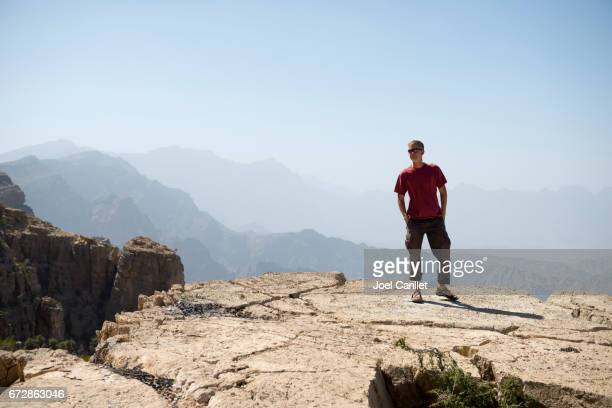 Tourist walking in rugged mountains of Oman