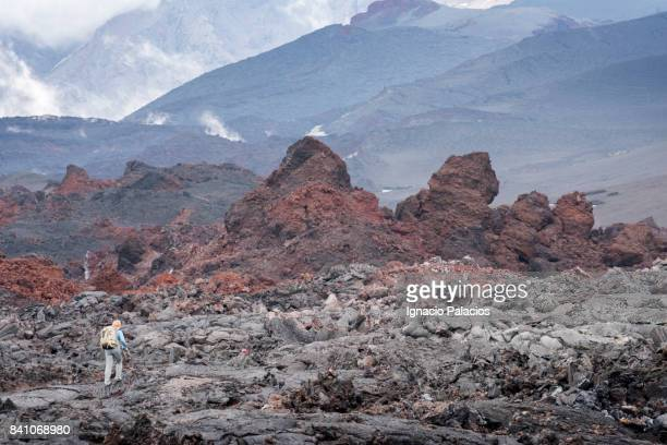 Tourist walking on a Lava field, Tolbachik volcanic complex, Kamchatka