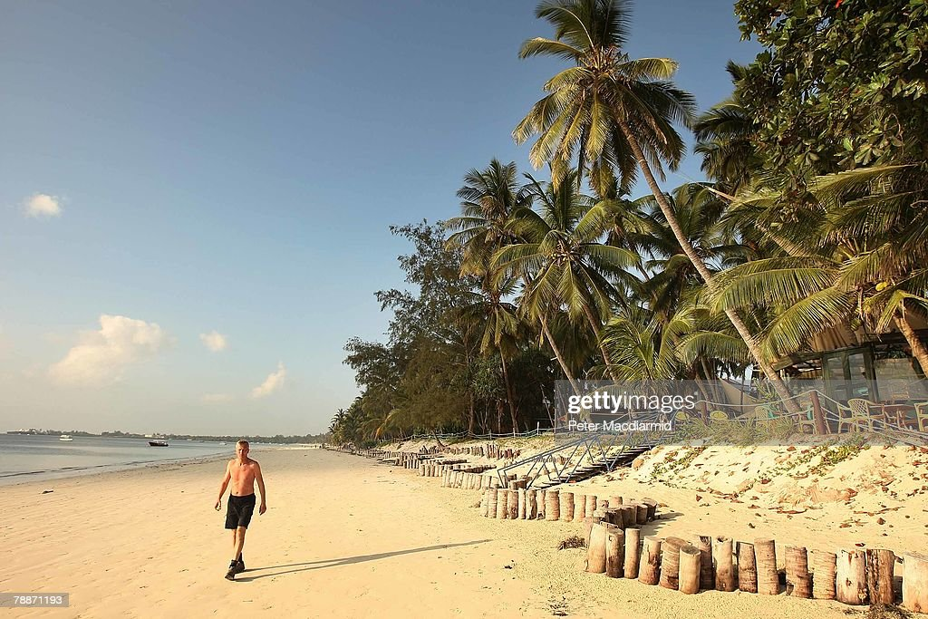 A tourist walks on the beach on January 10, 2008 in Mombasa, Kenya. Tourism is a $1 billion industry in Kenya. Some tour operators have temporarily banned package holidays over fear of post election violence.