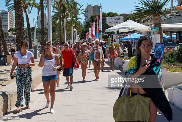 A tourist walks on the promenade at Magaluf beach on July 12 2014 in Mallorca Spain Magaluf is one of the Britain's favorite holiday destinations...