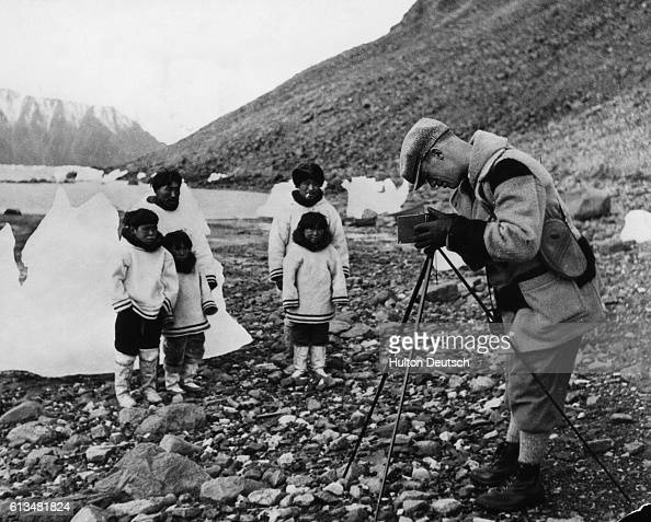 Tourist Warner Hall photographs Inuit parents and their children employed at the Craig Harbour Detachment of the Royal Canadian Mounted Police |...
