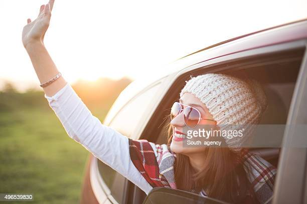 Tourist waving from the car