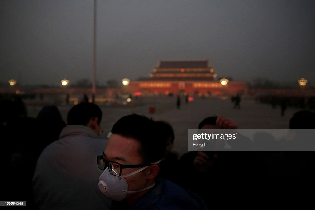 A tourist wearing the mask visits the Tiananmen Square at dangerous levels of air pollution on January 13, 2013 in Beijing, China.