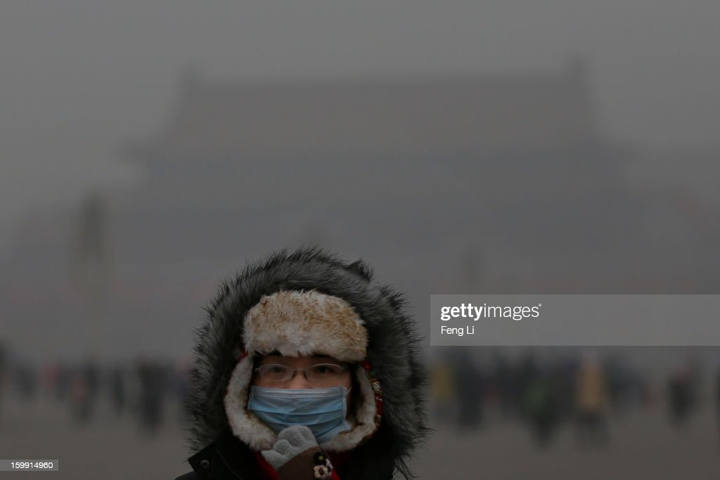 A tourist wearing the mask visits the Tiananmen Square at dangerous levels of air pollution on January 23, 2013 in Beijing, China. The air quality in Beijing on Wednesday hit serious levels again, as smog blanketed the city.