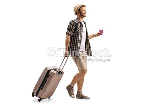 Tourist with a passport and a suitcase walking : Stock Photo