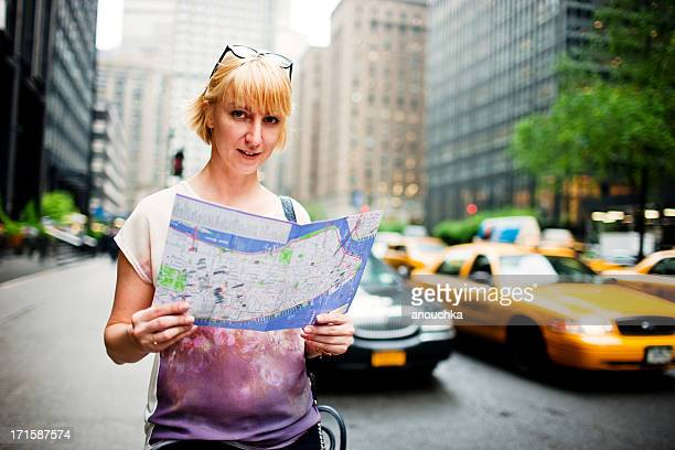 Tourist with city map on New York Street