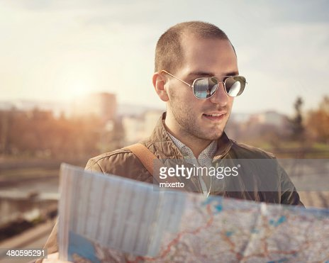 Tourist with map : Stock Photo