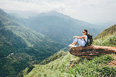 Tourist woman enjoy with beautiful view on mountains and valley in Ella, Sri Lanka, Little Adam Peak