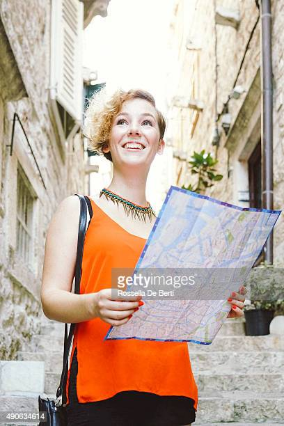 Tourist Woman Holding A City Map