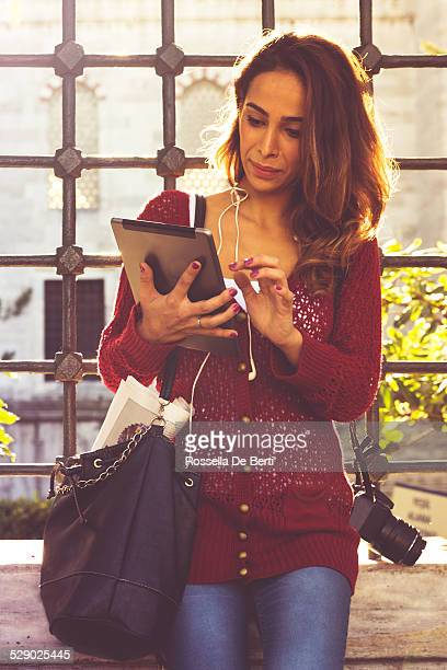 Tourist Woman Reading Newspaper On Tablet
