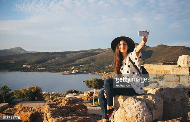 Tourist woman taking a selfie with her smartphone