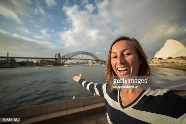 Tourist young woman in Sydney takes a selfie portrait