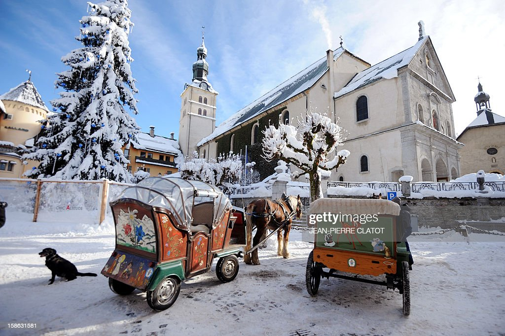 EMONET - Touristic horse-drawn carriages wait for clients on December 19, 2012 in the French luxuary ski ressort of Megeve, French Alps.