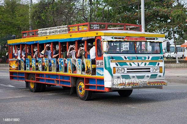Tourists aboard traditional Colombian Chiva bus.