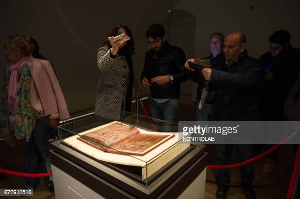 Tourists admire the Purple Codex or 'Codex Purpureus' kept under a glass teapot in an airconditioned multimedia room In October 2015 it was...
