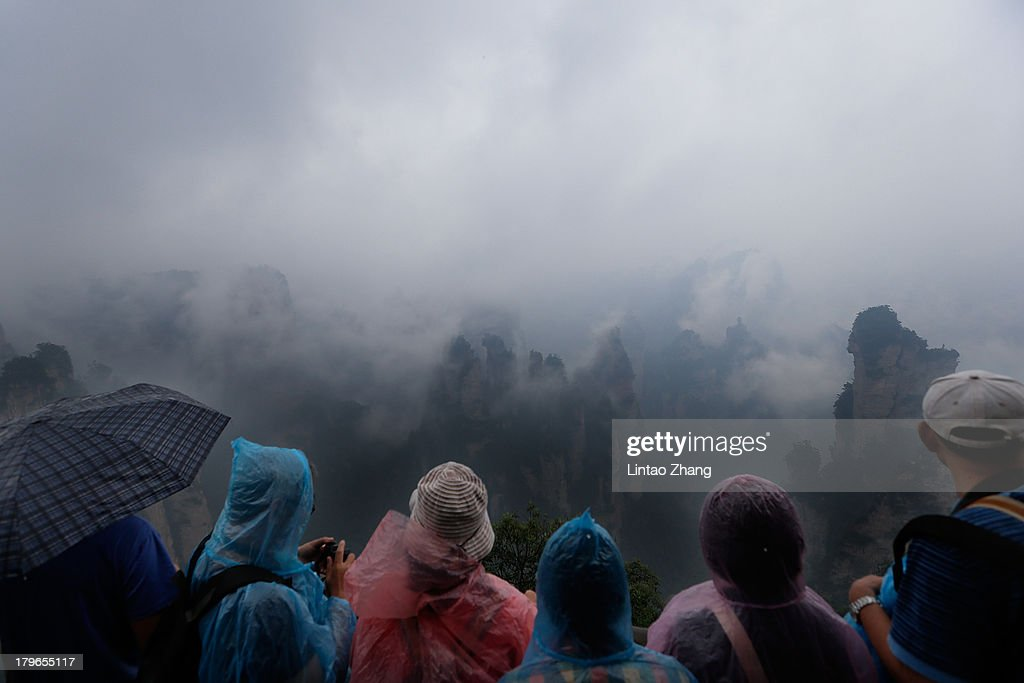 Tourists admire the view of the Tianzi Mountain at Zhangjiajie national park on September 1 2013 in Zhangjiajie China Zhangjiajie National Forest...