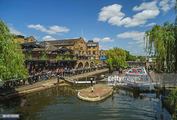 Tourists and canal boat at Camden Lock, London