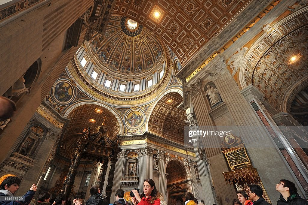 Tourists and faithful visit St Peter's basilica on February 13, 2013 at the Vatican. Pope Benedict XVI made his first public appearance on Wednesday since his shock resignation announcement, asking thousands of cheering pilgrims at the Vatican to 'keep praying for me'.