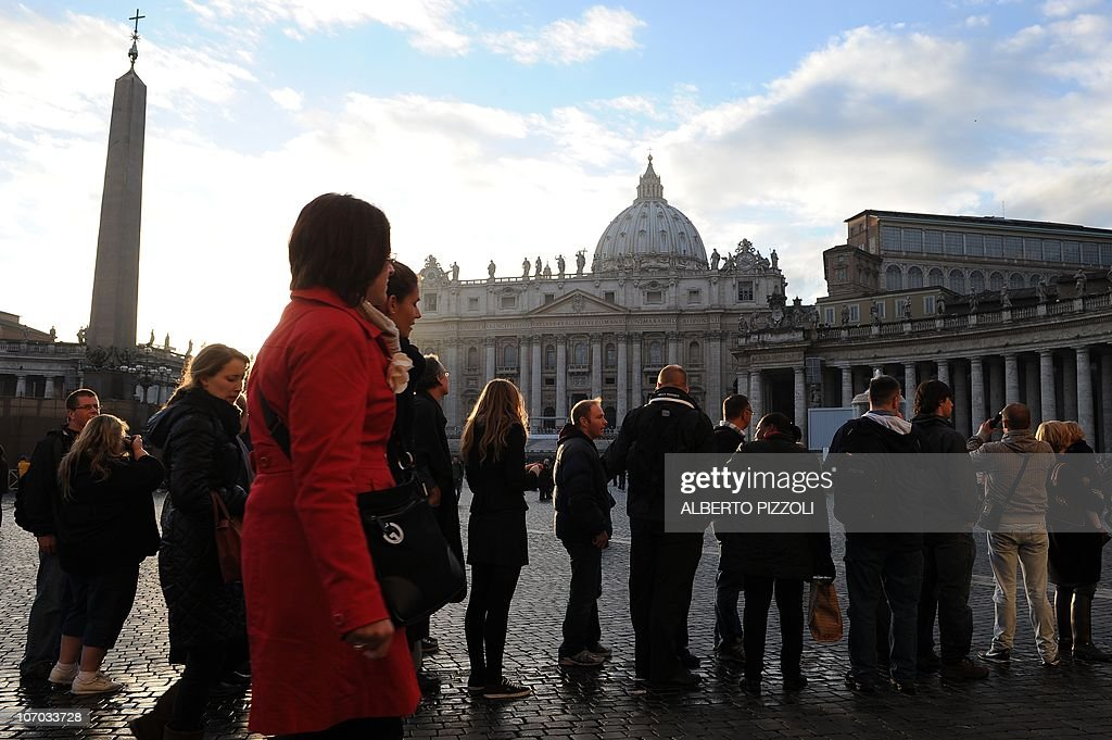 Tourists and faithful walk on St Peter's square on November 20 2010 on the day of a consistory at St Peter's basilica at The Vatican 24 Roman...