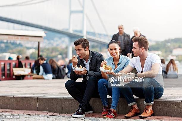 Tourists and friends having a snack in Ortakoy