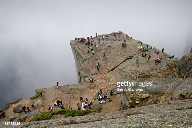 CONTENT] Tourists and hikers on Preikestolen / Prekestolen in English known as Preacher's Pulpit or Pulpit Rock The cliff hangs 600 meters above...