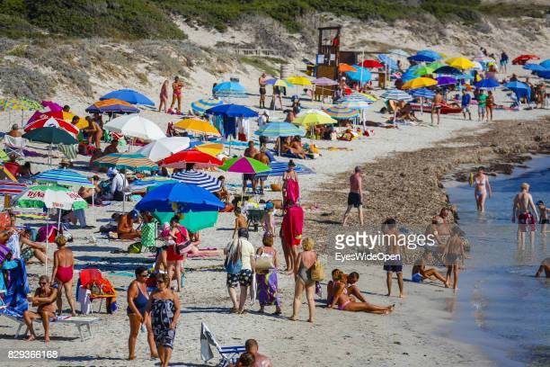 Tourists and local people enjoy the sun at Capo Testa beach on September 9 2014 in Cagliari Sardinia Italy