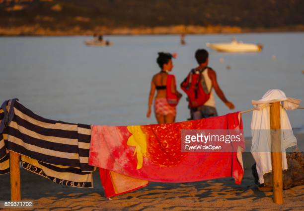 Tourists and local people enjoy the sun at Porto Pollo beach on September 9 2014 in Cagliari Sardinia Italy