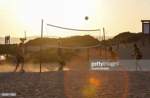 Tourists and local people playing beach volleyball and enjoy the sun at Porto Pollo beach on September 9 2014 in Cagliari Sardinia Italy