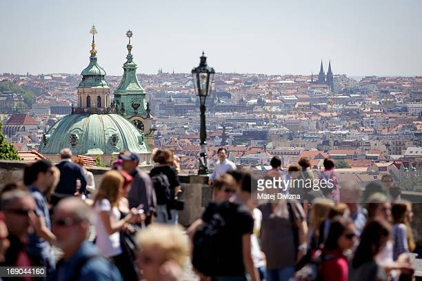 Tourists and locals look down on city centre on May 15 2013 in Prague Czech Republic St Nicholaus Church is in the background Prague is among...